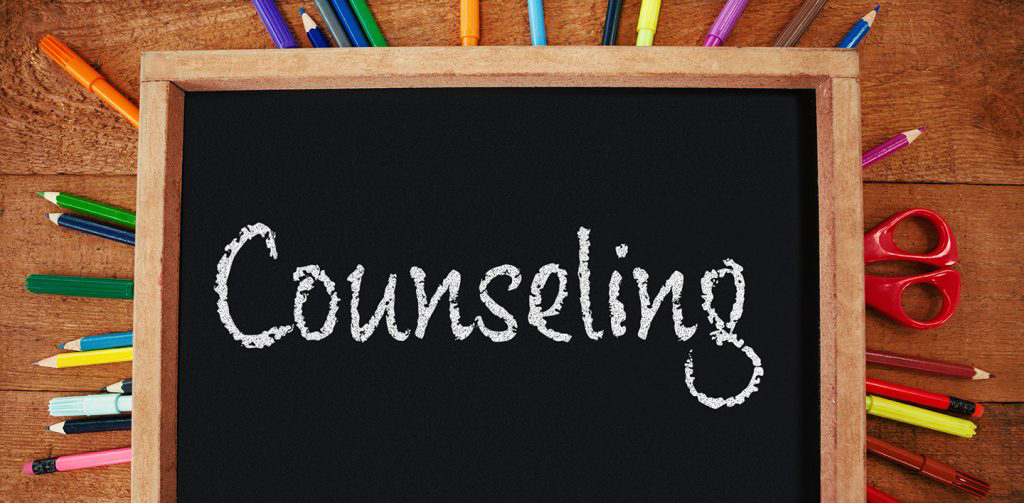 counseling written on a chalkboard surrounded by colorful pencils